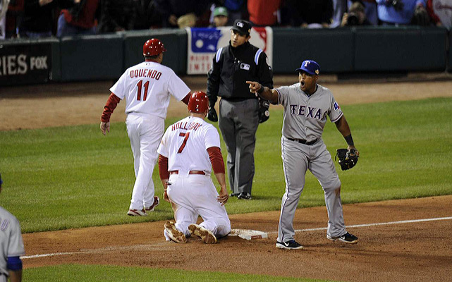 St. Louis' Matt Holliday reacts after Texas' Mike Napoli picked him off third base in the sixth inning.