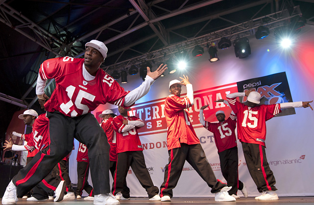 The British dance group performs at Trafalgar Square in London before a Broncos-49ers regular season game at Wembley Stadium.