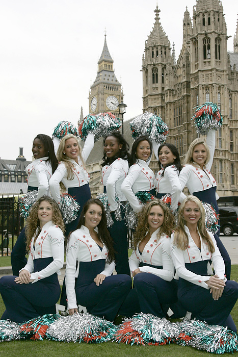 Miami cheerleaders pose outside of the Houses of Parliament in London.