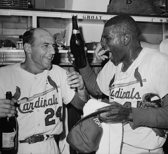 Groat and Gibson celebrate with champagne after winning the 1964 World Series. Gibson was a nine-time All-Star, a two-time World Series champion and a first-ballot Hall of Famer.