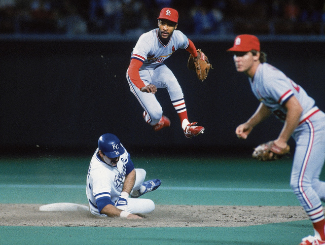 "The ""Wizard of Oz"" helps turns a double play against the Kansas City Royals in the 1985 World Series, which the Cardinals lost in seven games. Smith, a 13-time Gold Glove winner and 15-time All-Star, was a first-ballot Hall of Famer."