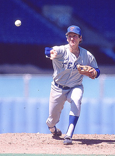 Hough tosses a pitch against the Blue Jays in 1989. A member of the Rangers' Hall of Fame, Hough was an All-Star in 1986.