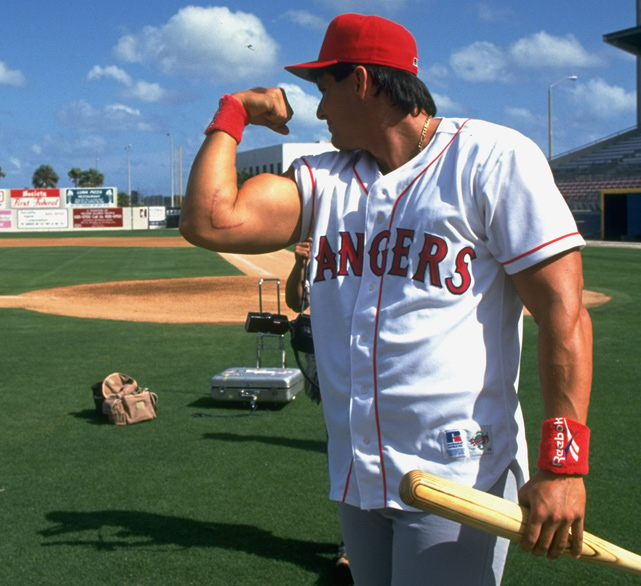 Canseco welcomes photographers to the gun show during spring training in 1994. Canseco, the 1988 AL MVP, played for the Rangers from 1992 to 1994.