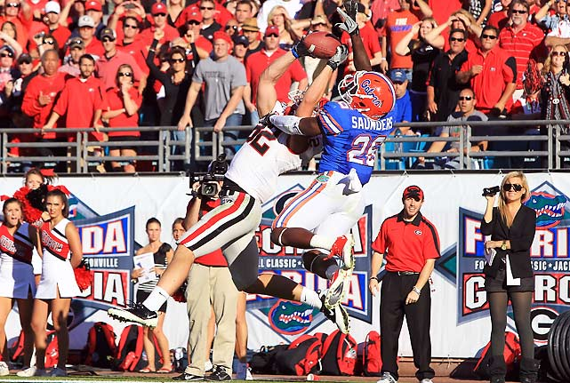 The monkey is off Mark Richt's back, at least for a little while. Georgia registered just its fourth victory in the last 22 meetings with SEC East rival Florida, allowing the Bulldogs to keep their divisional title hopes alive. Aaron Murray threw two touchdown passes on fourth-down to help the Bulldogs win their sixth straight; the Gators have lost four in a row.