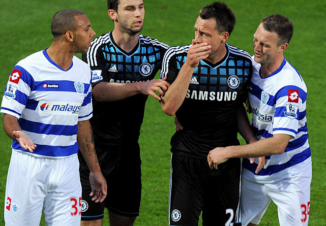 A  Turkey of the Year regular , Chelsea's John Terry (second from right) returns to SI.com's annual list after making headlines for all the wrong reasons. This time, his mouth did the damage: a racist remark at Queens Park Rangers defender Anton Ferdinand (left). Terry was subsequently placed under a police investigation in November.