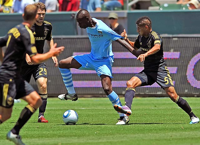 In one of the year's most embarrassing showboat productions, the maddeningly clownish Manchester City striker tried to backheel the ball into the back of the L.A. Galaxy's net during the World Football Challenge, flubbed the clear, easy shot (  CLICK HERE for video ) and was promptly subbed out by manager Roberto Mancini.