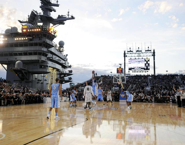 College basketball tipped off its 2011-12 season and saluted the troops on Veterans Day with Friday's Carrier Classic aboard the USS Carl Vinson. No. 1 North Carolina and Michigan State squared off aboard the ship docked in Coronado, Calif. with the Tar Heels pulling off a 67-55 victory. The game was played aboard the historic naval vessel, which is best known for burying Osama bin Laden at sea and being an instrumental tool in the war against terror. In addition to 7,000 fans and troops in attendance, President Barack Obama was also at the game and addressed the crowd before tip-off, honoring veterans who have protected the United States over the years.  Click through our gallery to check out more photos from the Carrier Classic.