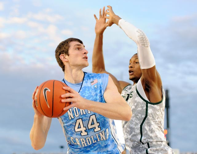 North Carolina big man Tyler Zeller posts up during the first half of Friday's Carrier Classic. Zeller chipped in nine points and six rebounds for the Heels.