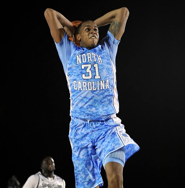 North Carolina forward John Henson soars for a breakaway dunk during Friday's Carrier Classic.