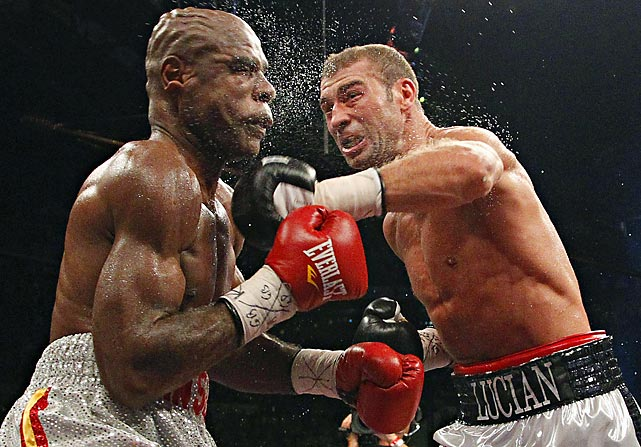 Lucian Bute, the IBF super middleweight champion, lands a left on the face of Glen Johnson in Quebec. Bute successfully defended his title.