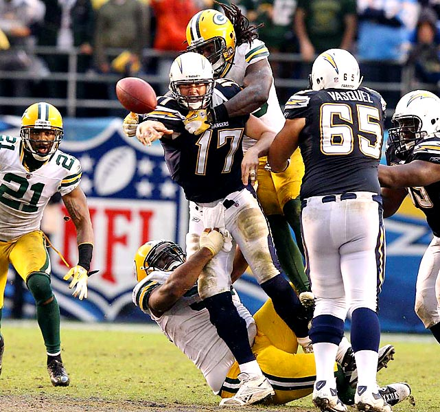 San Diego quarterback Philip Rivers gets rid of the ball before he's taken down. Rivers and the Chargers fell 45-38 to the undefeated Green Bay Packers.