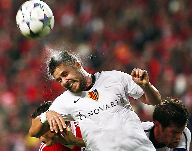 FC Basel's Markus Steinhoefer heads a ball during a UEFA Champions League Group C soccer match against Benfica in Lisbon, Portugal. Steienhoefer's squad played to a 1-1 draw.