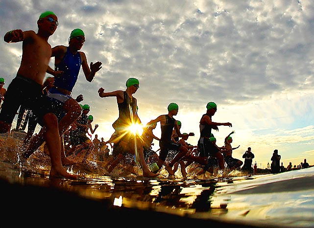 Competitors enter the water during the Brighton Triathlon in Australia.