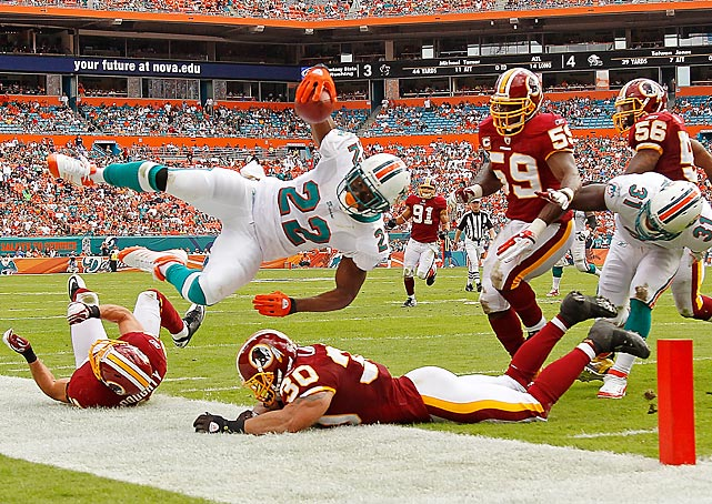 Dolphins running back Reggie Bush dives for the endzone against the Washington Redskins. Bush had two touchdowns in Miami's 20-9 win.