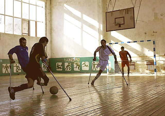 Chechnya landmine victims hold a soccer practice in a sports hall in the Chechen capital of Grozny. More than 3,000 mine accidents have occurred in the country since 1994, according to UNICEF Russia.