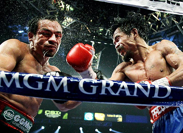 Manny Pacquiao lands a right hand against Juan Manuel Marquez during the WBO welterweight title fight in Las Vegas. Pacquiao won by majority decision.