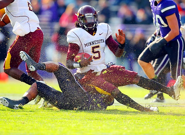 Northwestern linebacker David Nwabuisi tackles Minnesota quarterback Marqueis Gray during the Wildcats' 28-13 victory.