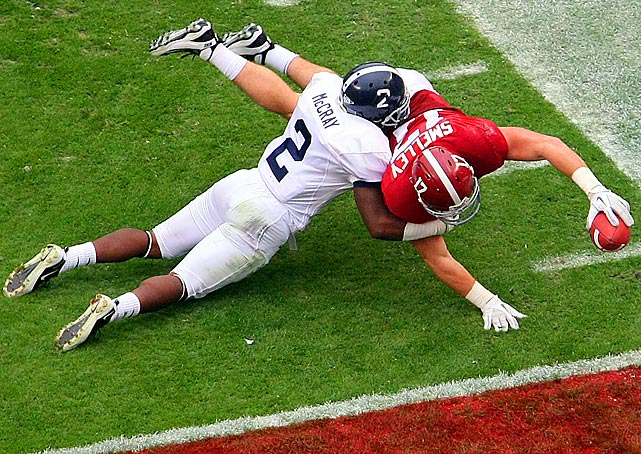 Alabama tight end Brad Smelley dives past Georgia Southern safety A.J. McCray to score a touchdown in the Cimson Tide's 45-21 rout.