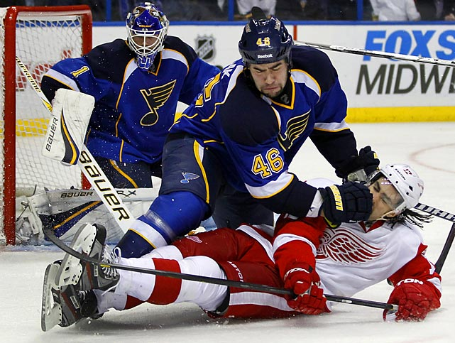 St. Louis defenseman Roman Polak takes down Detroit winger Patrick Eaves in the third period of the Blues' 2-1 victory.
