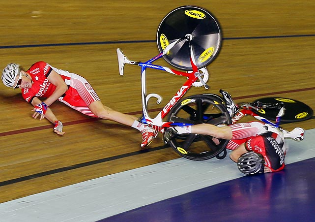 Sam Harrison (left) and Joe Kelly collide during a time trial at the Revolution Track Series cycling competition in Manchester, England.
