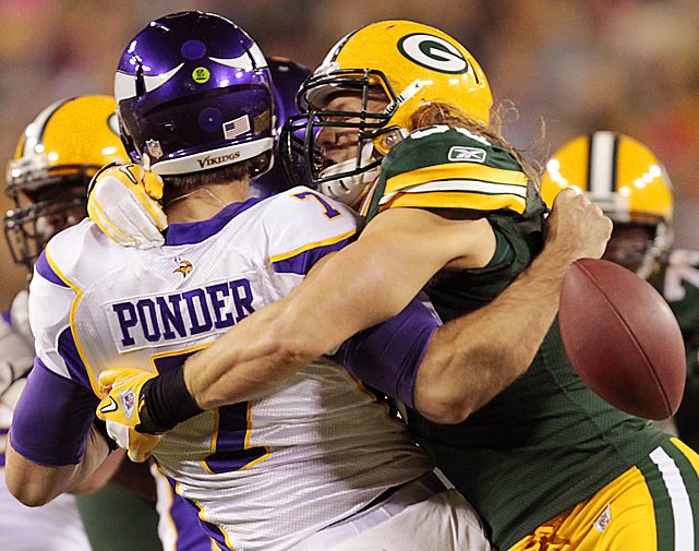 Minnesota quarterback Christian Ponder loses the football as he's hit by Green Bay linebacker Clay Matthews. The Vikings would recover the fumble, but lose the Monday Night Football game 45-7.