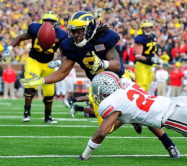 Ohio State defensive back Bradley Roby tackles Michigan wide receiver Martavious Odoms. Odoms scored a touchdown to help the Wolverines beat the Buckeyes (40-34) for the first time since 2003.
