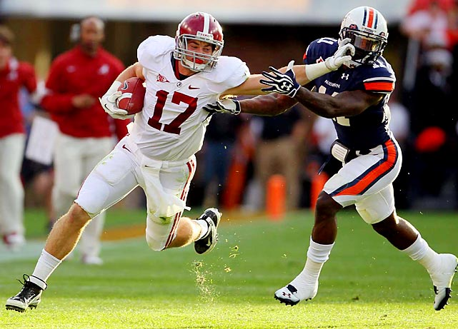 Alabama tight end Brad Smelley (left) stiff-arms Auburn corner Chris Davis during the Crimson Tide's 42-14 victory.