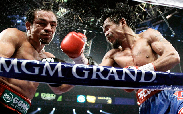 Manny Pacquiao was taken to the limit Saturday night before escaping with a decision win over Juan Manuel Marquez in their welterweight title fight. Pacquiao won on two scorecards, while the third ringside judge called it a draw. It was a narrow escape for Pacquiao, who took as much punishment as he got over 12 rounds.