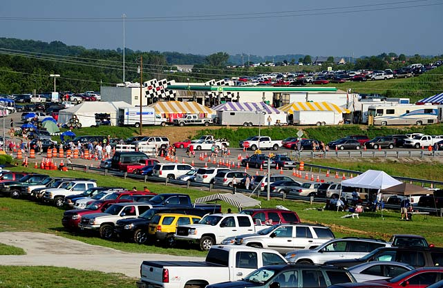 One of NASCAR's biggest controversies occurred on the way to the track at the first-ever Cup race at Kentucky Speedway in Sparta, Ky. Speedway Motorsports Incorporated (SMI) expanded the track from 61,000 seats to 107,000 prior to the Cup debut, but the infrastructure around the track was unable to accommodate such a crowd. Interstate 71, which is the main artery from the North of Cincinnati to the South of Lexington and Louisville, is essentially two lanes in each direction, which created a massive traffic jam with as many as 20,000 race fans unable to even get to the track. Many of those fans were turned away by the Kentucky State Police because the traffic pattern was being reversed. Needless to say, many of those fans vowed would never visit the track again.
