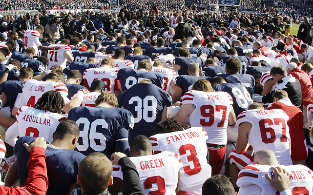 Players and coaches from both Penn State and Nebraska gathered at midfield for a pregame prayer given by a Nebraska assistant coach.