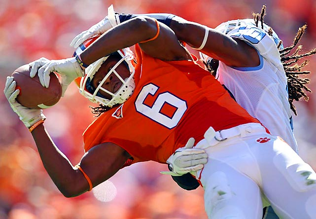 Clemson's DeAndre Hopkins catches a ball despite being tangled up with a North Carolina defender.