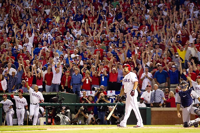 Nelson Cruz of the Texas Rangers admires his walk-off grand slam to win Game 2 of the ALCS; this was the first walk-off grand slam in postseason history.