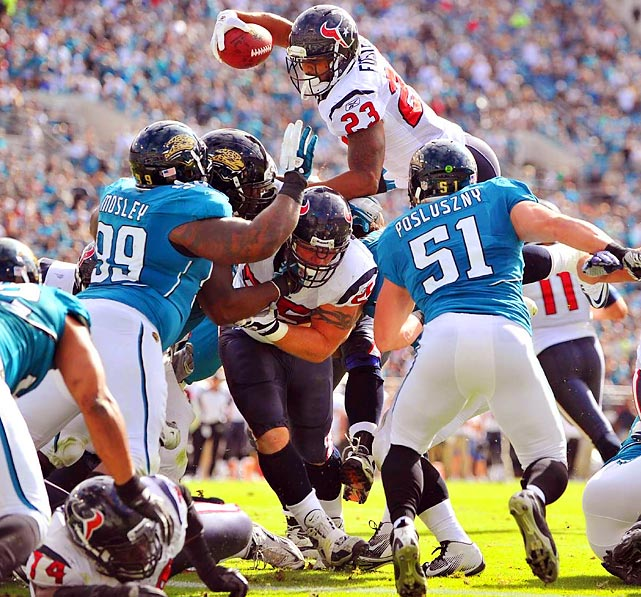 Houston Texans running back Arian Foster goes up and over the Jacksonville Jaguars for a touchdown.