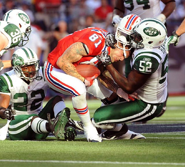 Jets linebacker David Harris tackles Patriots tight end Aaron Hernandez by the head.