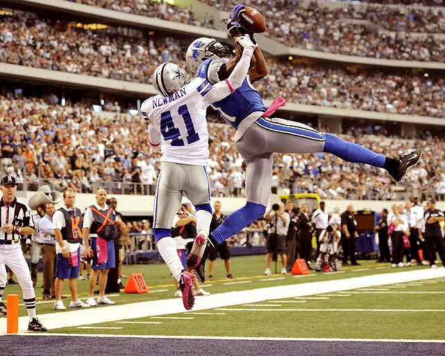 Detroit Lions wide receiver Calvin Johnson makes a leaping touchdown catch over Dallas cornerback Terence Newman.