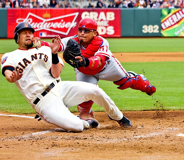 San Francisco's Aubrey Huff was trying to score from third, but Philadelphia Phillies catcher Carlos Ruiz met him at home plate with the ball.