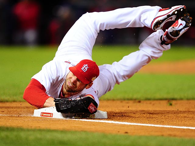 Chris Carpenter of the St. Louis Cardinals turns in a hustle play during Game 1 of the World Series against the Texas Rangers.