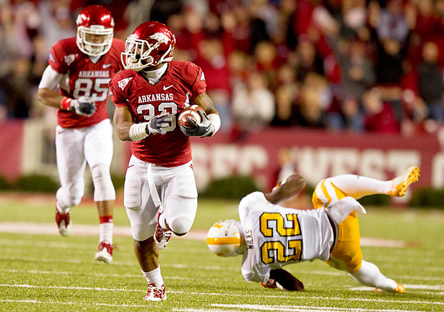 Tyler Wilson threw for three touchdowns, and Dennis Johnson (pictured) ran for two more, totaling 96 yards on 11 carries. Arkansas improved to 9-1 on its way to a Black Friday showdown with No. 1 LSU. The loss dropped Tennessee to 4-6. The Vols must beat Vanderbilt and Kentucky to become bowl eligible.