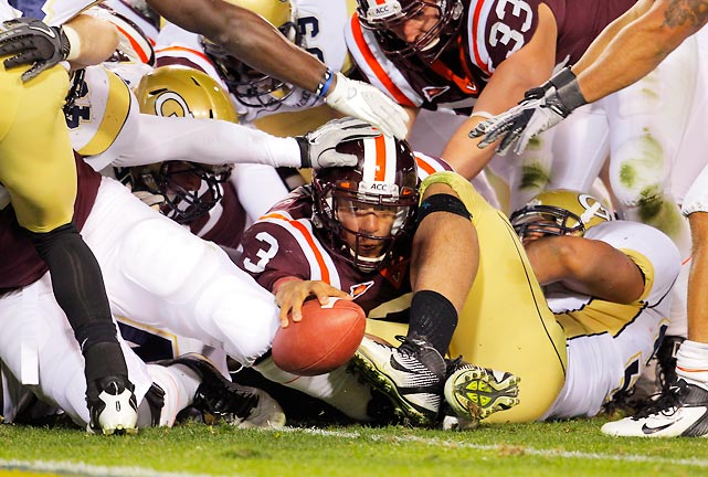 Virginia Tech (9-1) put itself back in the ACC Coastal Division driver's seat and eliminated Georgia Tech (7-3) from conference-title contention with a 37-26 win on Thursday night. Mammoth Hokies quarterback Logan Thomas (pictured) proved too much for the Yellow Jackets to handle, passing for three touchdowns and rushing for two more.
