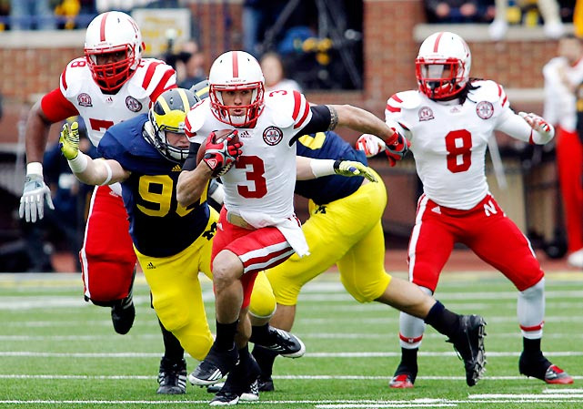 Denard Robinson passed for 179 yards and two touchdowns and rushed for 84 yards and two additional scores and Fitz Toussaint rushed 29 times for 134 yards and two touchdowns. But Michigan also won with defense, which smothered Taylor Martinez (pictured) and the Huskers and held them to 256 net yards.