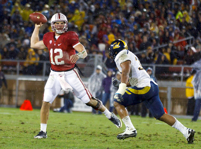 Andrew Luck threw for 257 yards and two touchdowns, and Stanford survived a shaky start to beat rival Cal in a rain-soaked Big Game. Luck revived his Heisman campaign by tossing scores to Levine Toilolo and Ryan Hewitt, keeping the Cardinal's slim chances of a Pac-12 title and national championship alive.