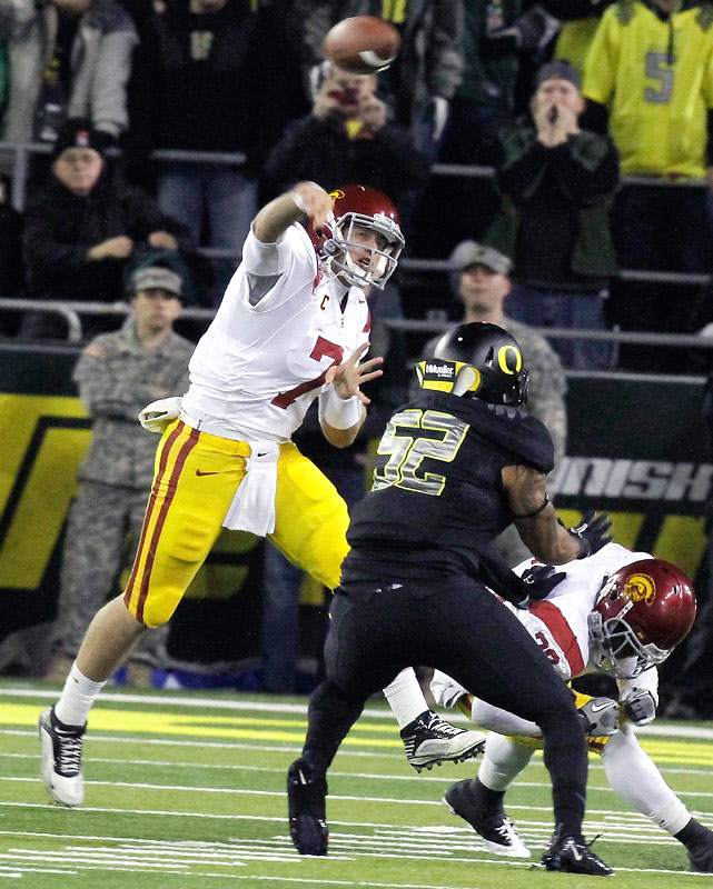 Matt Barkley threw for 323 yards and four touchdowns and the Trojans held off the Ducks when Alejandro Maldonado missed a 37-yard field goal to tie the game with five seconds left.