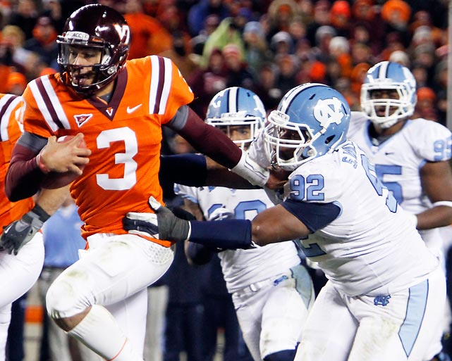 Virginia Tech hasn't wrapped up the ACC Coastal yet, but it moved one step closer on Thursday night by beating upset-minded UNC. Logan Thomas (pictured) passed for two touchdowns and rushed for another as Tech built a 24-7 lead and then held off UNC's rally. The Hokies clinch with a Virginia loss to Florida State this week or a head-to-head win next week.