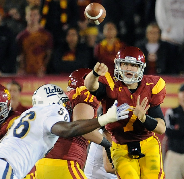 Matt Barkley (right) passed for 423 yards and six touchdowns in his possible Coliseum farewell, Robert Woods set the conference's single-season receptions record while catching 12 passes for 113 yards and two TDs, and Southern California finished its resurgent season with a demolition of Pac-12 title game-bound UCLA.