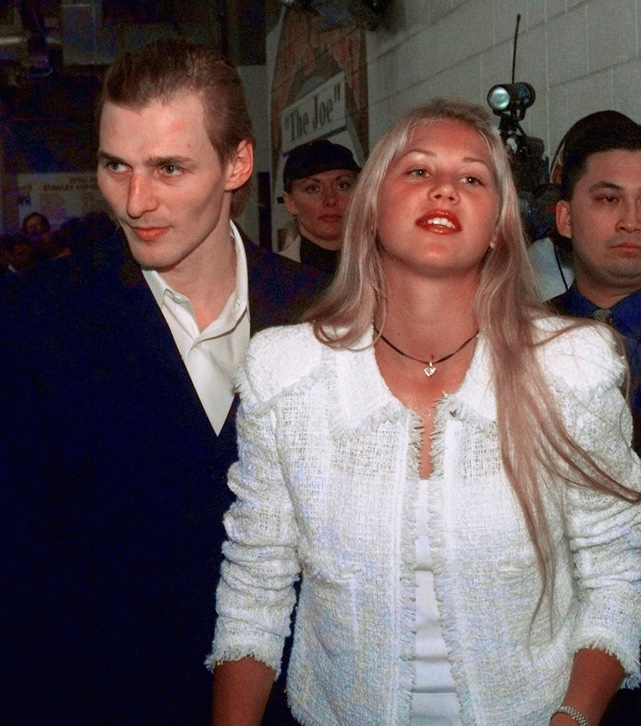 Federov leaves after a 1998 hockey game at Joe Louis Arena with tennis star Anna Kournikova. Fedorov claims he and Kournikova were married in 2001, but later divorced in 2003. Kournikova denies the marriage ever took place.
