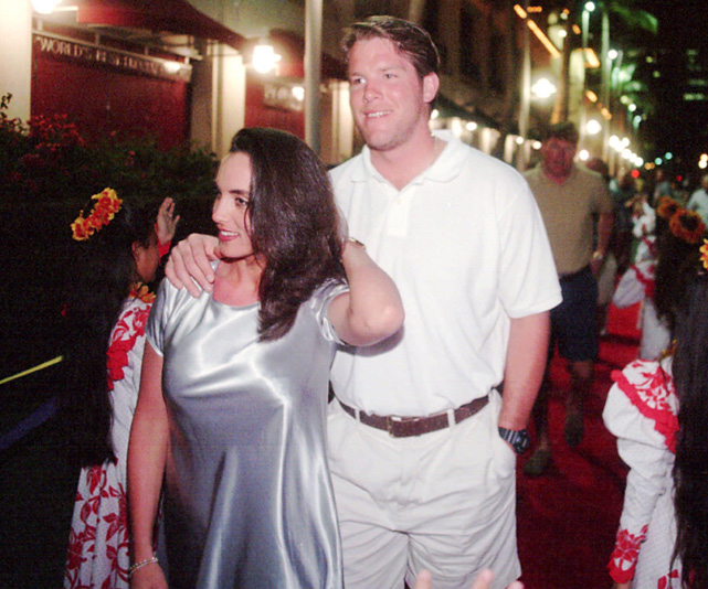 Favre arrives at the 1996 Pro Bowl with girlfriend Deanna Tynes. The couple started dating when Favre was a quarterback at Southern Mississippi; they've been married since 1996.