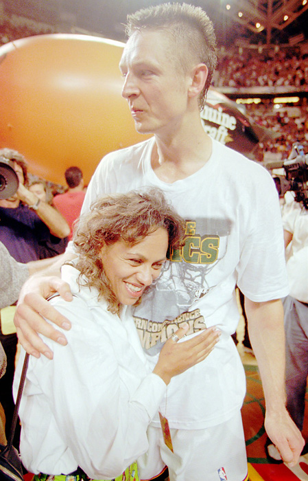 The former Sonic gets a hug from wife Mary after a win in 1996. The couple has two sons.