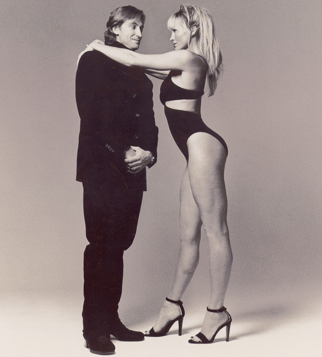Gretzky and actress Janet Jones pose for the 1998 Sports Illustrated Swimsuit Issue. Gretzky and Jones have been married since 1988 and have five children.