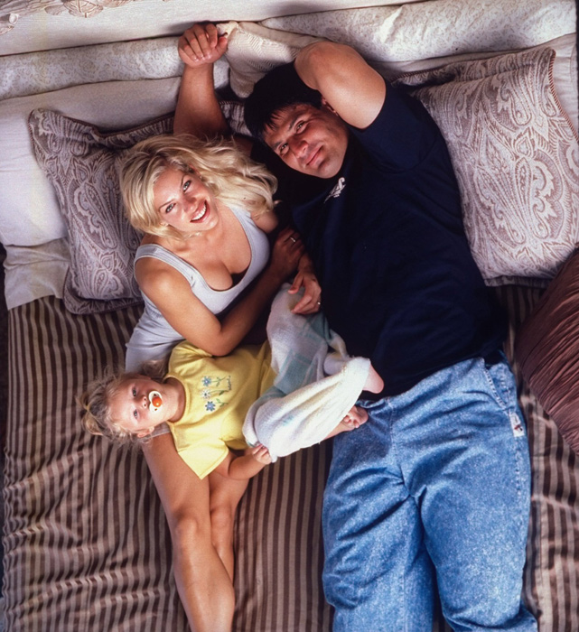 Canseco and his wife pose with their daughter Josie at their home during Canseco's time with the Tampa Bay Devil Rays. The couple is no longer married.