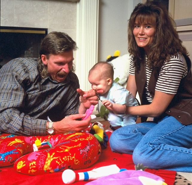 Johnson and wife Lisa play with their daughter Samantha during a 1995 SI photo shoot. Randy and Lisa have three other children, Tanner, Willow and Alexandria.